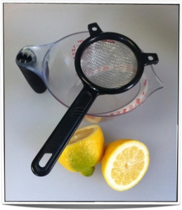 The lemon juicing rig. The strainer is to catch and seeds or errant clumps of pulp.