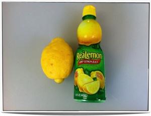 A real lemon (C. × limon) and a bottle of ReaLemon.