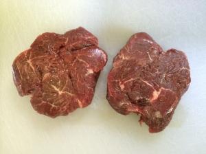 Raw steaks, unpacked.