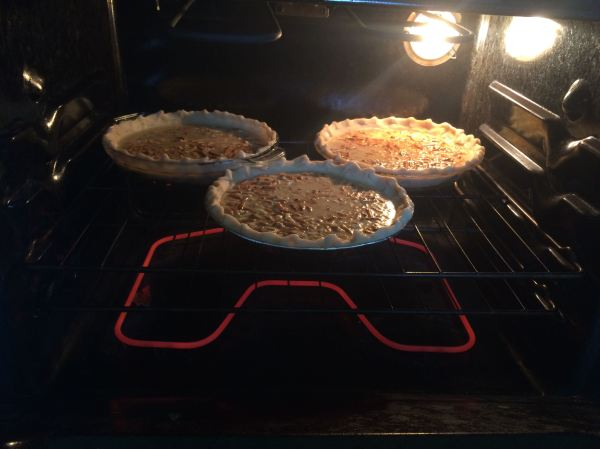 Faux-pecan pies  in the oven. Pies were rotated/rearranged mid-way through baking.