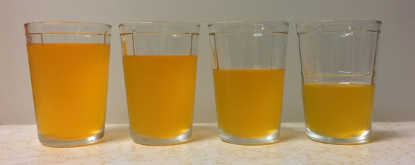 Left to right is 4:1, 3:1, 2:1, and 1:1 ratios of orange sports drink to vodka.