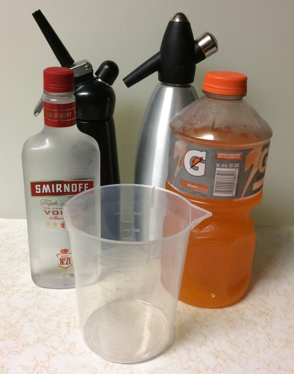 Left to right: vodka, nitrous whipper, graduated cylinder, seltzer siphon, gatorade (with electrolytes).